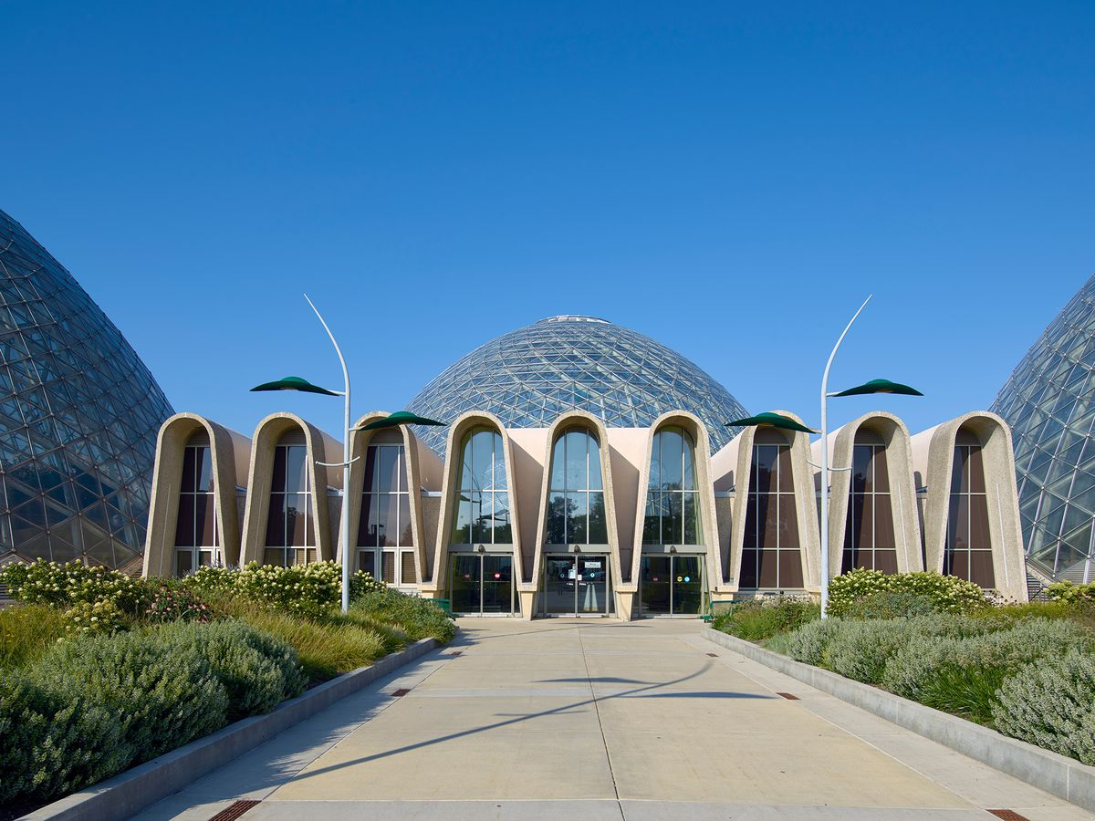 The exterior of the Mitchell Park Horticultural Conservatory. There are multiple glass domes. The entrance is a series of arches.