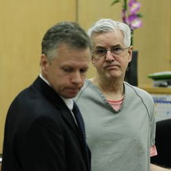 """Steve Powell, right, appears in a Pierce County Superior Court hearing with his attorney, Mark Quigley, left, Monday, April 23, 2012, in Tacoma, Wash. Quigley said Monday that investigators frustrated by their unsuccessful quest to find Powell's missing daughter-in-law pursued an """"illegal"""" warrant that eventually led to voyeurism charges against Powell."""
