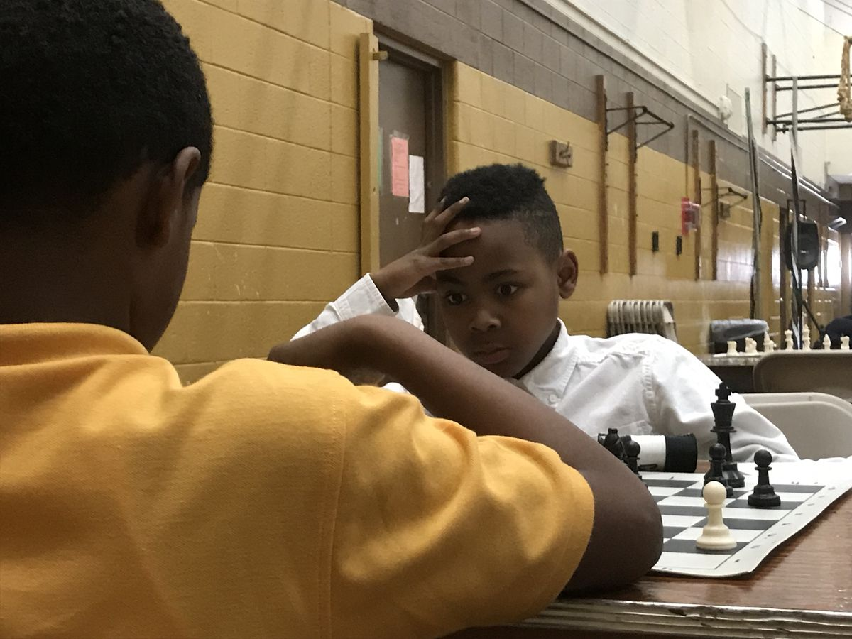 Judah Smith, 10, a fifth-grader at Bates Academy, concentrates as he plays a chess game during the state elementary tournament Saturday.