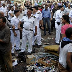 Egyptian street vendors salvage what they can of their belongings as police clear Tahrir Square in Cairo, Egypt, Saturday, Sept. 15, 2012 after days of protests near the U.S. embassy over a film insulting Prophet Muhammad.