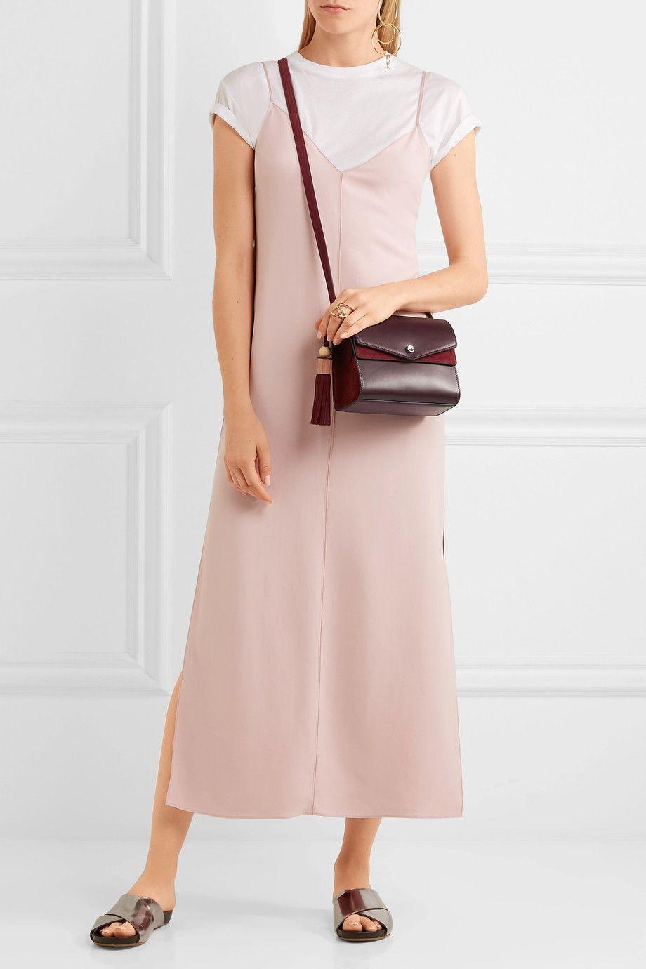 A burgundy suede shoulder bag