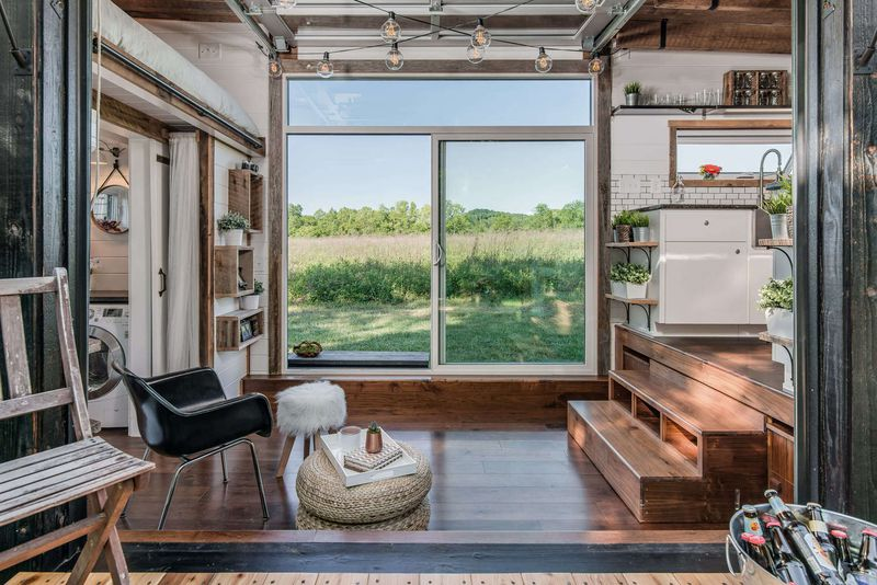 small homes with roof deck tricked out tiny home features garage door and custom deck curbed