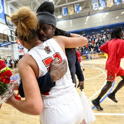 Judge Memorial's Teya Sidberry (32) hugs her father Tyrees Sidberry after defeating Grantsville in the 3A girl's basketball semifinals at the Lifetime Activities Center in Taylorsville on Friday, Feb. 21, 2020.