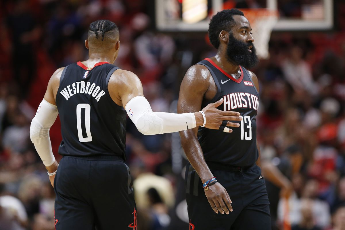 Russell Westbrook of the Houston Rockets celebrates with James Harden against the Miami Heat during the first half at American Airlines Arena on October 18, 2019 in Miami, Florida.