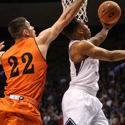 Brigham Young Cougars guard Jahshire Hardnett (0) switches hands with the ball and lays it up under the arms of Idaho State Bengals forward Jacob McCord (22) as BYU takes on Idaho State at the Marriott Center in Provo on Thursday, Dec. 21, 2017.