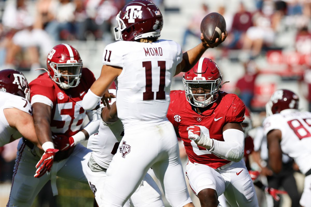 Christian Harris of the Alabama Crimson Tide rushes Kellen Mond of the Texas A&M Aggies on October 3, 2020 at Bryant-Denny Stadium in Tuscaloosa, Alabama.