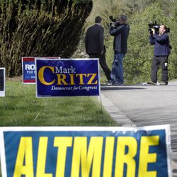 U.S. Rep. Jason Altmire, D- Pa., left, is followed by television cameras as he walks out of the polling area after he he voted in the Pennsylvania primary election on Tuesday, April 24, 2012 in McCandless, Pa., a suburb north of Pittsburgh. Altmire faces fellow U.S. Rep. Mark Critz after the Legislature and governor approved new lines combining their previously separate districts.