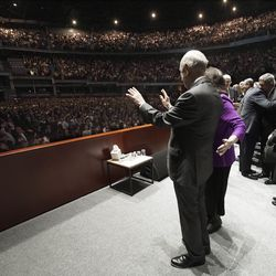 President Russell M. Nelson of The Church of Jesus Christ of Latter-day Saints and his wife Sister Wendy Nelson greet attendees during a devotional at Movistar Arena in Bogota, Colombia, on Sunday, Aug. 25, 2019.