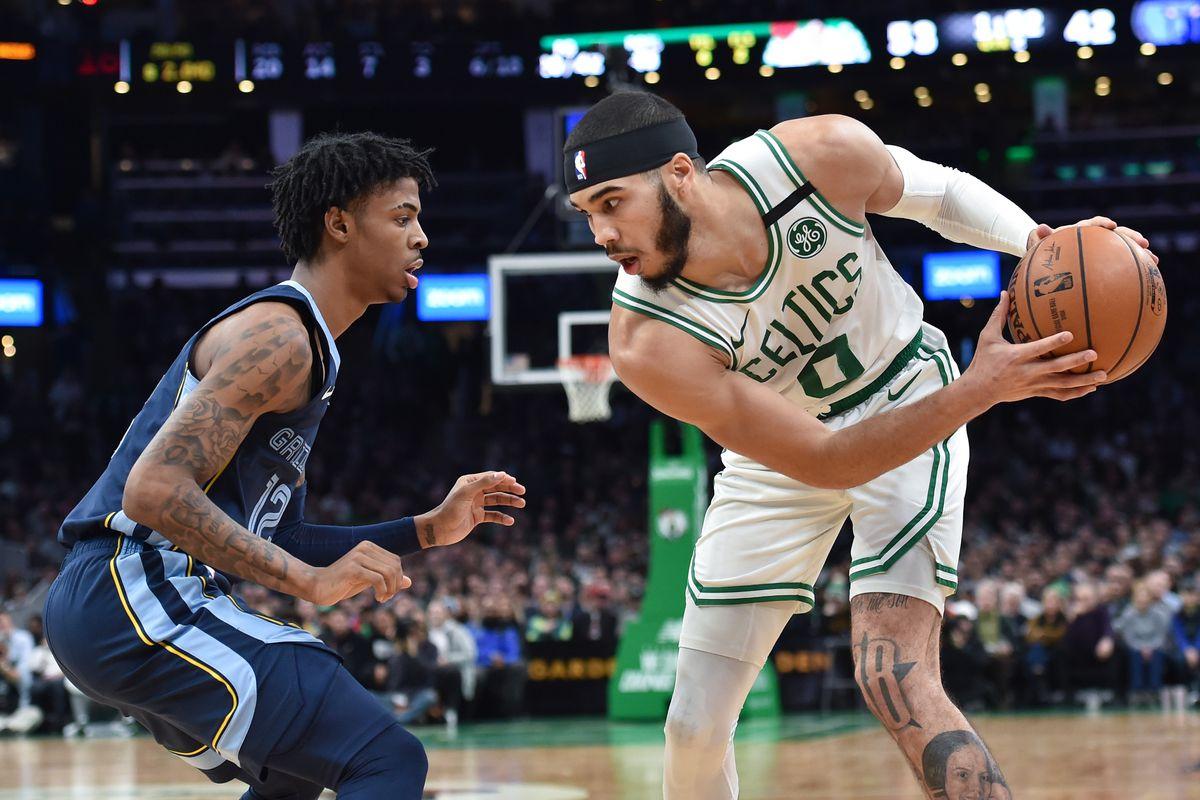 Memphis Grizzlies guard Ja Morant guards Boston Celtics forward Jayson Tatum during the first half at TD Garden.