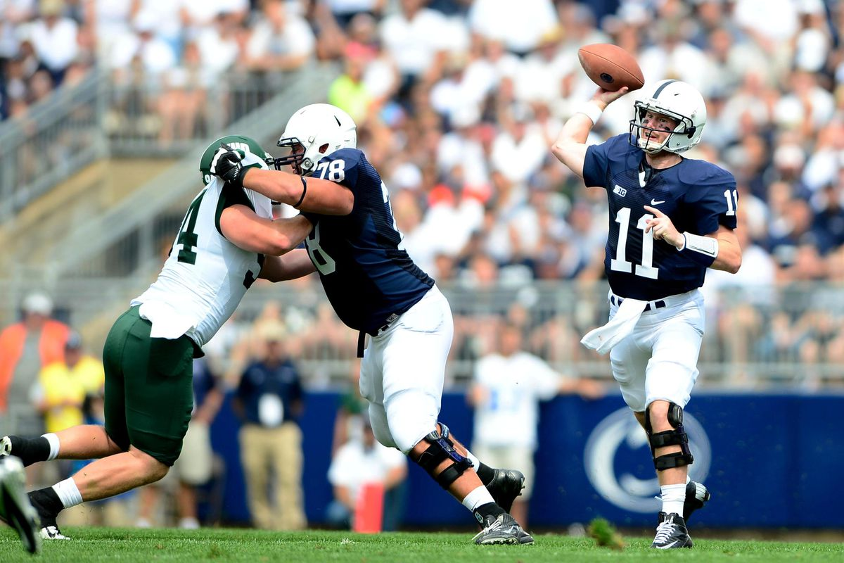 Sep 1, 2012; University Park, PA, USA; Penn State Nittany Lions quarterback Matthew McGloin (11) looks to pass in the first quarter against the Ohio Bobcats at Beaver Stadium. Mandatory Credit: Andrew Weber-US Presswire