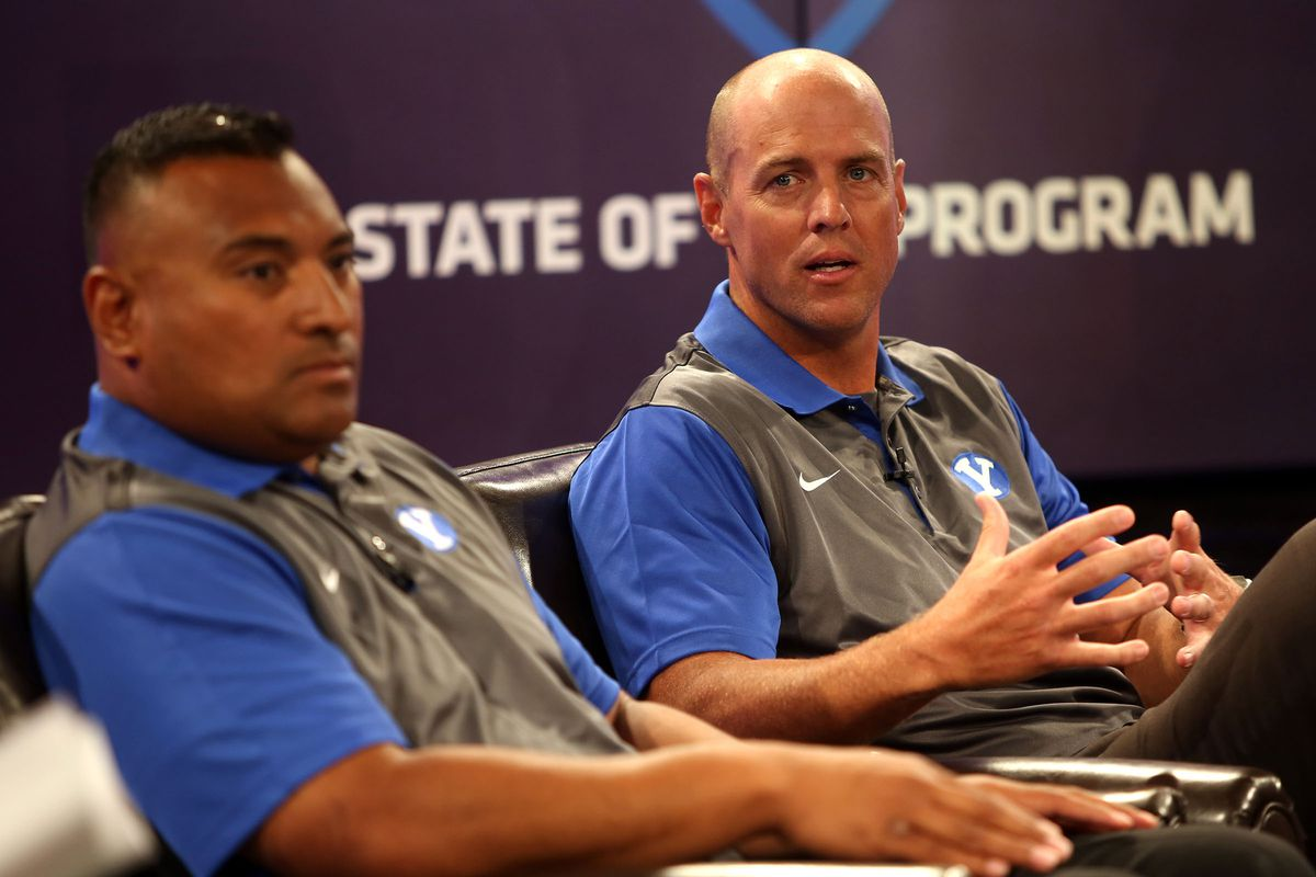 Assistant head coach Ed Lamb answers questions with head coach Kalani Sitake, left, during BYU Media Day at BYU Broadcasting in Provo on Thursday, June 30, 2016.
