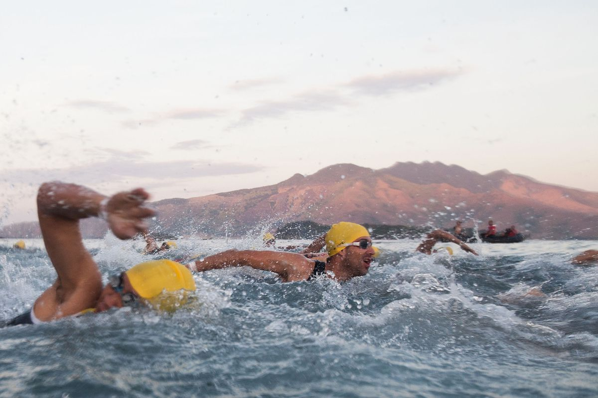 Participants take part in the Challenge Philippines 2014 triathalon on February 22, 2014 in Subic Bay, Philippines.