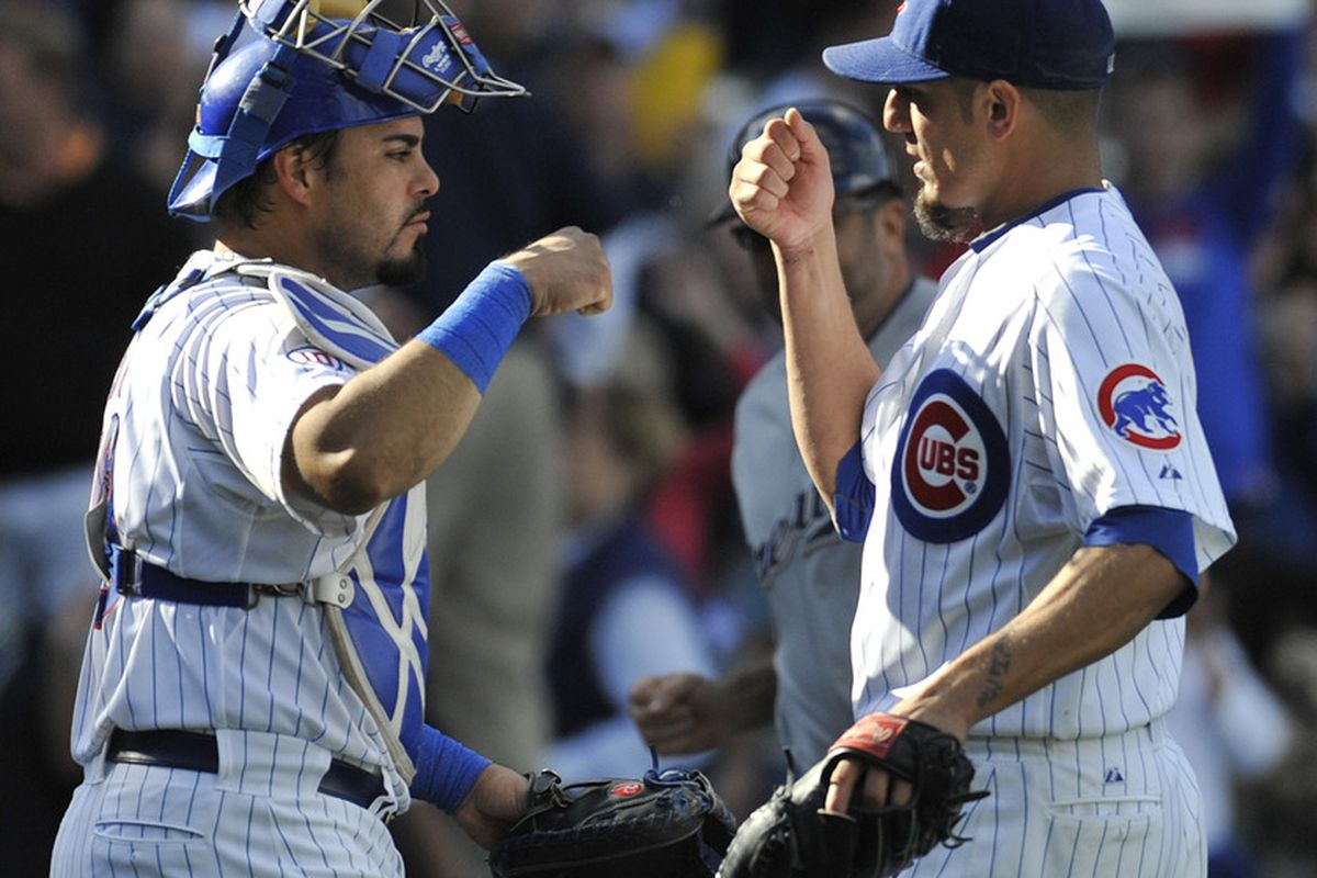 Matt Garza of the Chicago Cubs and Geovany Soto celebrate a Cubs victory against the Milwaukee Brewers at Wrigley Field in Chicago, Illinois. Both players will get raises in 2012. (Photo by David Banks/Getty Images)