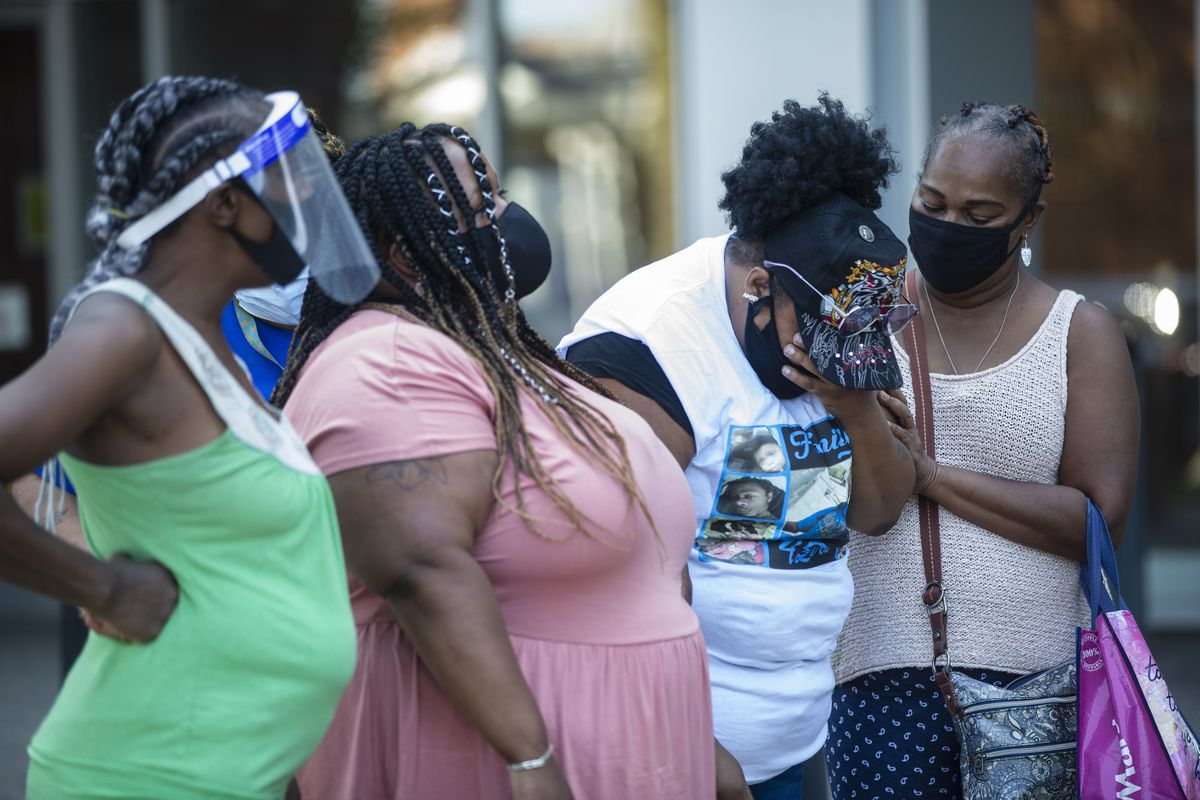 Angelica Mann, second from the left, cries during a news conference July 16 outside the Chicago Police Department headquarters.
