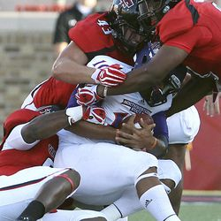 FILE - In this Sept. 1, 2012, file photo, Northwestern State's Brad Henderson is taken down by Texas Tech's Kerry Hyder,left, Jackson Richards(43) and Delvon Simmons, right, during their NCAA college football game in Lubbock, Texas. Texas Tech has long been known for slinging passes all over the Big 12.  No longer, at least through Texas Tech's first three games against non-conference opponents. The Red Raiders (3-0) are No. 2 in the nation in total defense (120 yards per game) and in passing defense (85 ypg).
