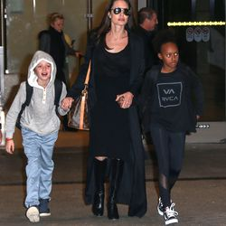 Both Angelina Jolie and her daughter Zahara wore all-black while returning to LAX from Cambodia. Photo: Fame Flynet
