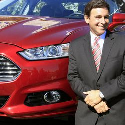 Mark Fields, Ford president of the Americas, stands next to a 2013 Fusion at the Flat Rock Assembly in Flat Rock, Mich., Monday, Sept. 10, 2012. The plant, formerly known as AutoAlliance International will continue to produce the Mustang and add the Fusion next year. Flat Rock Assembly will be the U.S. producer of the Fusion, employing 2,900 workers on both vehicle lines.