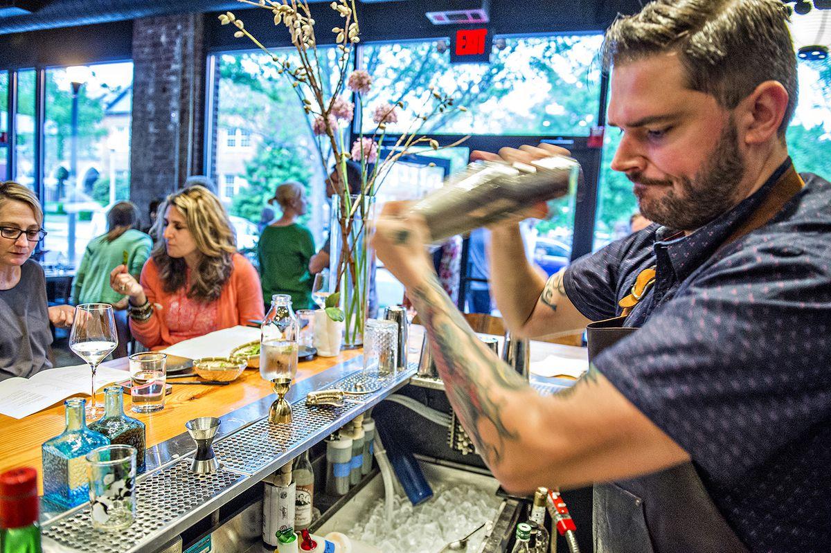 Jeff Banks shakes up a cocktail at Brush Sushi Izakaya.