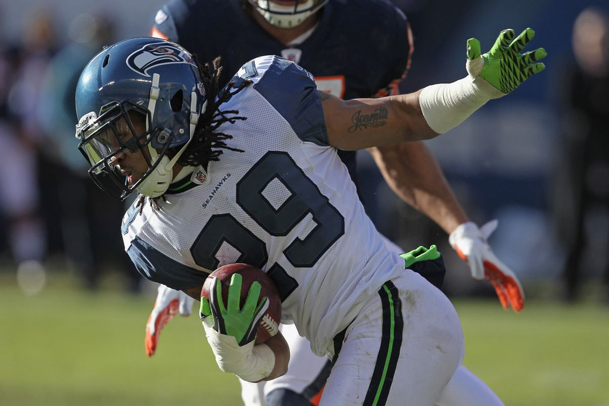 CHICAGO, IL - DECEMBER 18: Earl Thomas #29 of the Seattle Seahawks returns an interception against the Chicago Bears at Soldier Field on December18, 2011 in Chicago, Illinois. (Photo by Jonathan Daniel/Getty Images)