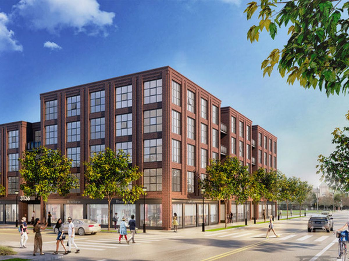 A rendering of a red brick building with multiple windows.