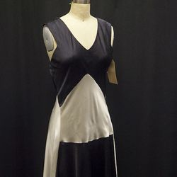 The Capulet women wear this striking, black-and-white dress.