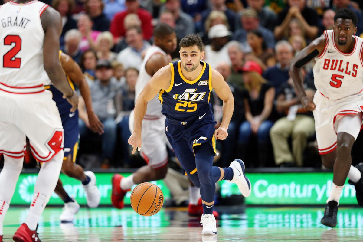 Utah Jazz guard Raul Neto (25) chases down a lose ball as the Utah Jazz and the Chicago Bulls play an NBA basketball game at Vivint Arena in Salt Lake City on Wednesday, Nov. 22, 2017.