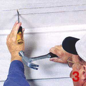 Person using a hammer and chisel on the ceiling.