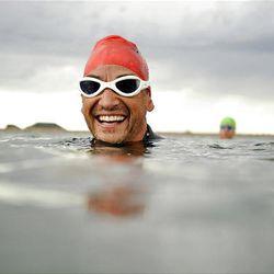 John Karren trains for a 10-kilomenter open-water swim race at Deer Creek Reservoir.