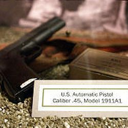 A pistol is part of the 96th Infantry Division exhibit. From April 1 to June 30, 1945, the division fought on Okinawa, where an estimated 240,000 soldiers and civilians were killed.
