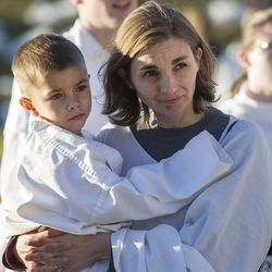 Jill Miller holds her son Jacob among the 1,039 participants who met Monday, Dec. 1, 2014, at Rock Canyon Park in Provo to set a world record for the largest live Nativity.