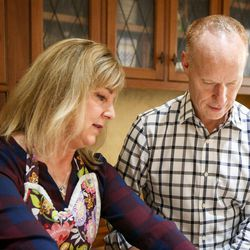 Michelle and Jon Schmidt prepare a meal in their home in Provo on Friday, Nov. 24, 2017.