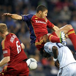 KANSAS CITY, KS - APRIL 14:  Alvaro Saborio #15 of Real Salt Lake topples over Kei Kamara #23 of Sporting Kansas City as they compete for the ball during the Major League Soccer game on April 14, 2012 at Livestrong Sporting Park in Kansas City, Kansas.  (Photo by Jamie Squire/Getty Images)