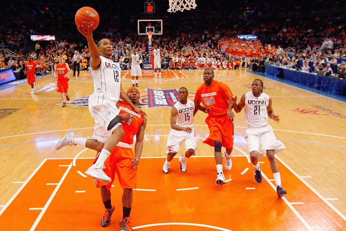 A.J. Price of the Connecticut Huskies makes a layup against the Syracuse Orange during the quarterfinals of the Big East Tournament at Madison Square Garden on March 12, 2009 in New York City. (Photo by Jim McIsaac/Getty Images)