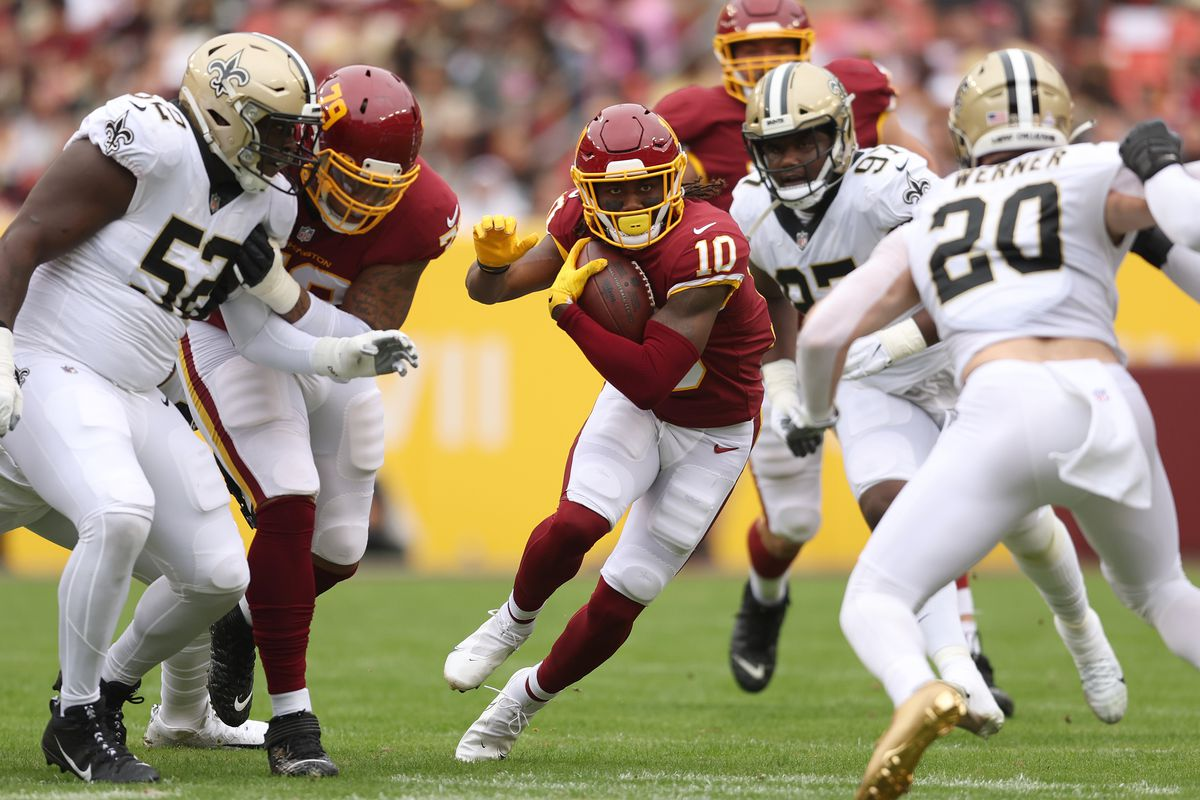 Curtis Samuel #10 of the Washington Football Team runs with the ball during the first half a New Orleans Saints at FedExField on October 10, 2021 in Landover, Maryland.