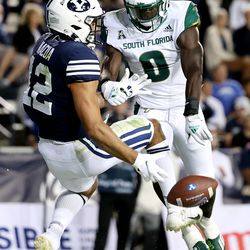 Brigham Young Cougars wide receiver Puka Nacua (12) has the ball knocked away in the end zone by South Florida Bulls defensive back Daquan Evans (0) as BYU and USF play a college football game at LaVell Edwards Stadium in Provo on Saturday, Sept. 25, 2021. BYU won 35-27.