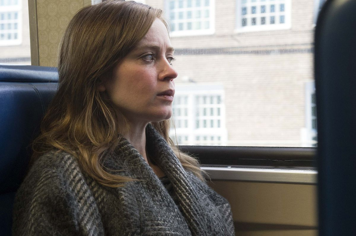 Emily Blunt looks out the train window.