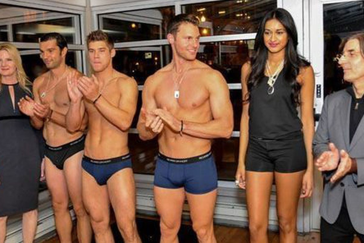 The designers flanking tight, toned models in Richard Dayhoff underwear and Tracey Mayer jewelry