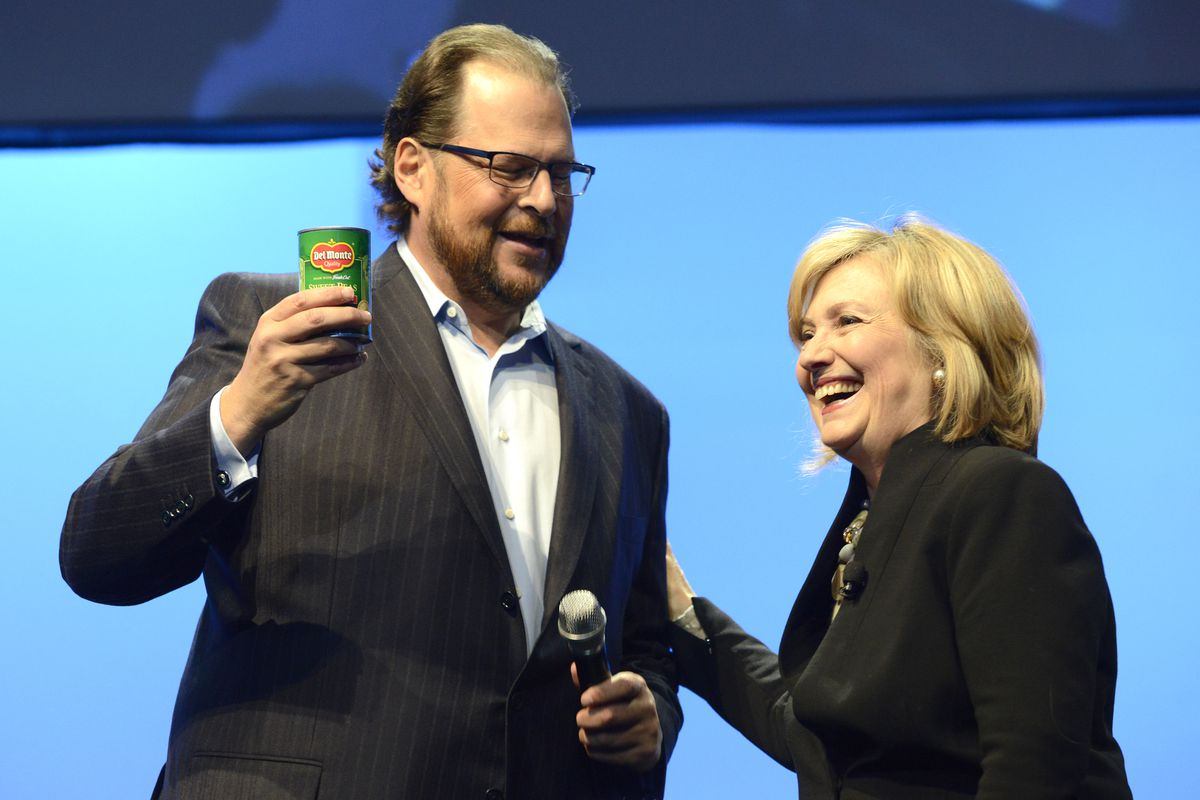 Marc Benioff stands onstage with Hillary Clinton in 2014.