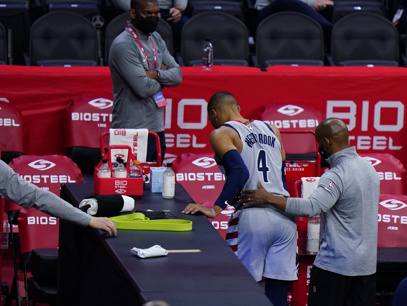 The Washington Wizards' Russell Westbrook is helped to the locker room after an injury Wednesday.