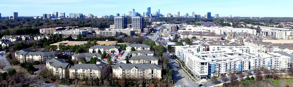 A panorama of Buckhead in Atlanta with many building in white and glass.