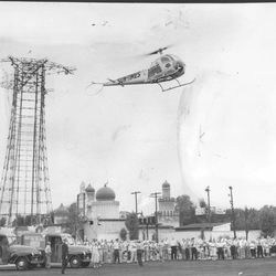 The Sun-Times helicopter delivers newspapers to the parking lot at Riverview Park in 1956.   Sun-Times Archives