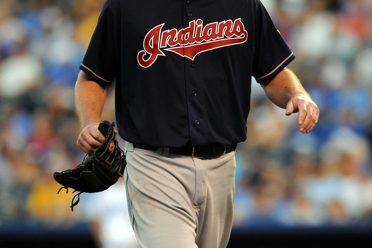 Jul 31, 2012; Kansas City, MO, USA; Cleveland Indians starting pitcher Derek Lowe is relieved by manager Manny Acta (not shown) in the third inning against the Kansas City Royals at Kauffman Stadium. Mandatory Credit: John Rieger-US PRESSWIRE