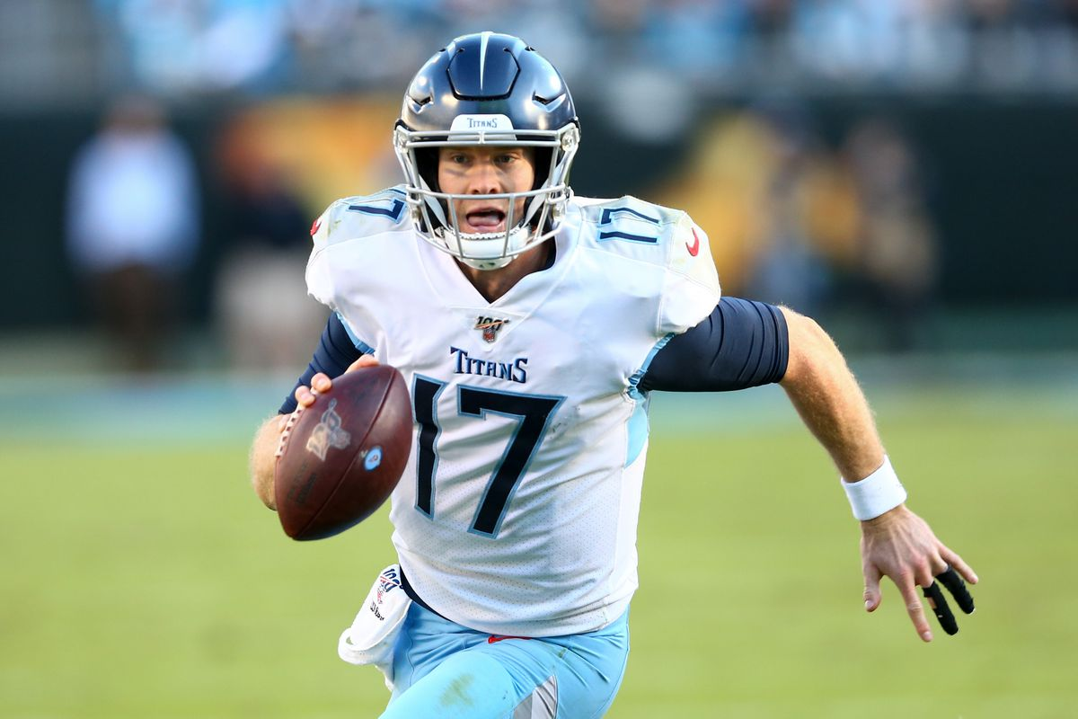 Tennessee Titans quarterback Ryan Tannehill (17) carries the ball during the fourth quarter against the Carolina Panthers at Bank of America Stadium.