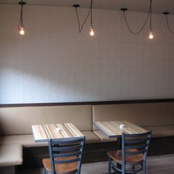 A glimpse at the dining room in the rear. All together, the dining room seats 49 people.