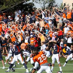 Broncos fans stretch out with the team.