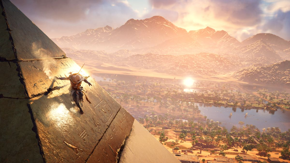 Assassin's Creed Origins - Bayek scales a pyramid