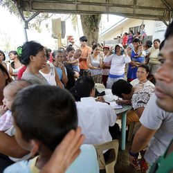 People gather to sign up for relief goods in Tacloban, Friday, Nov. 22, 2013.