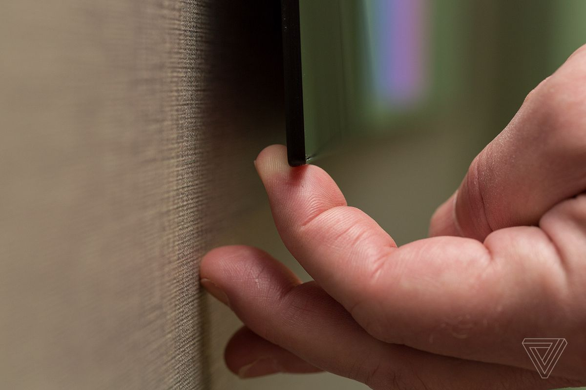 LG's new flagship 4K OLED TV is stunningly thin - The Verge