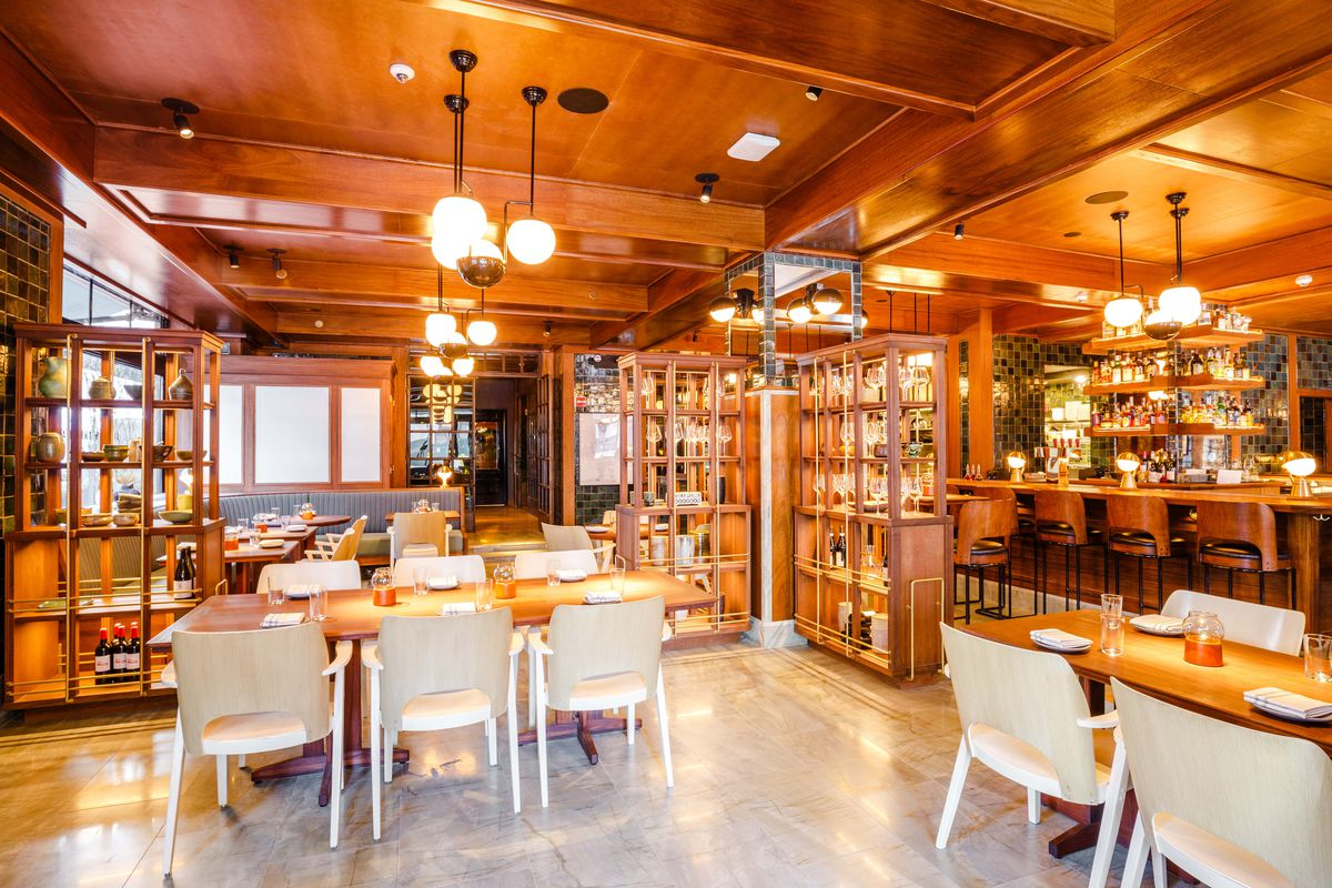 The wood-filled dining room at Simon & the Whale