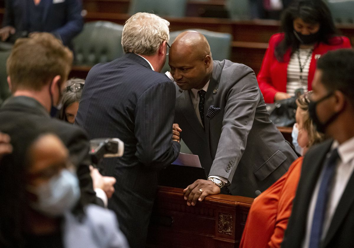 """Illinois House Republican Leader Jim Durkin, center left, R-Western Springs, speaks with Illinois Speaker of the House Emanuel """"Chris"""" Welch, D-Hillside, on Tuesday."""